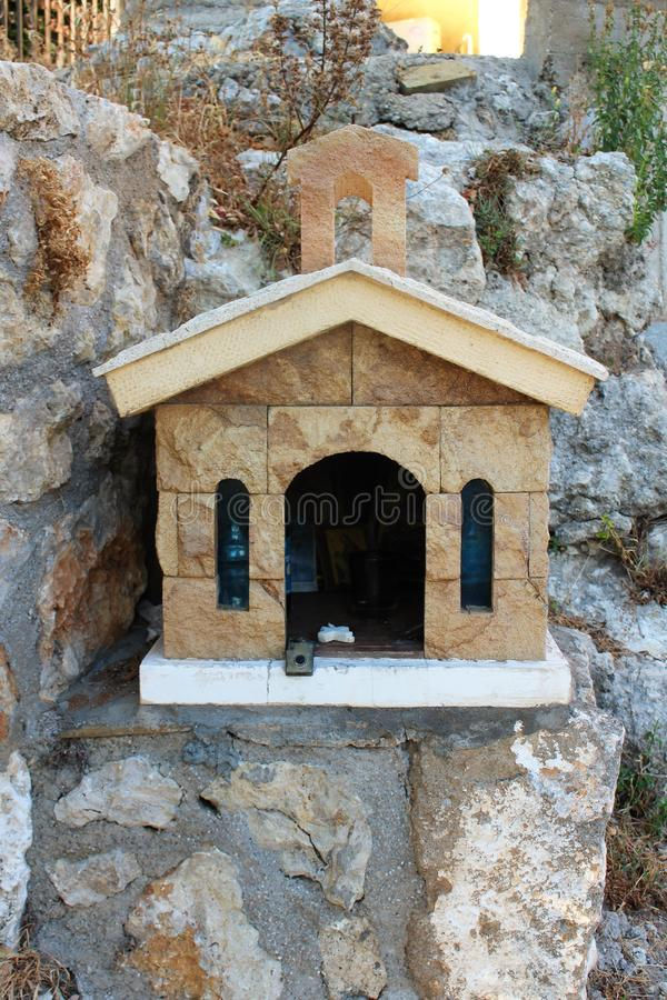 A small road church in Crete. In Greece, small chapels are built at the roadside to honor someone who lost their live on the road. Accident, altar, believe stock images