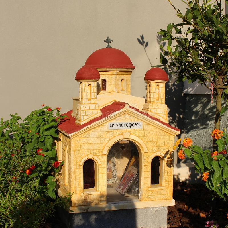 A small road church in Crete. In Greece, small chapels are built at the roadside to honor someone who lost their live on the road royalty free stock images