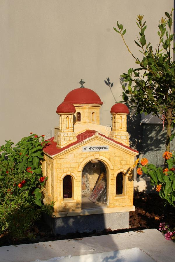 A small road church in Crete. In Greece, small chapels are built at the roadside to honor someone who lost their live on the road stock images