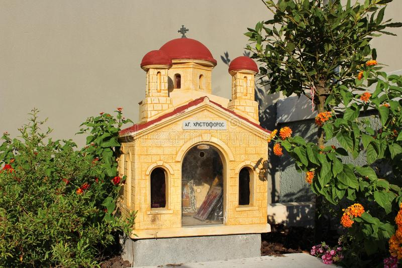 A small road church in Crete. In Greece, small chapels are built at the roadside to honor someone who lost their live on the road stock image