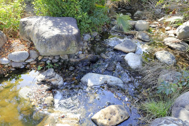 Tranquil stone creek and small pool, adobe rgb stock images