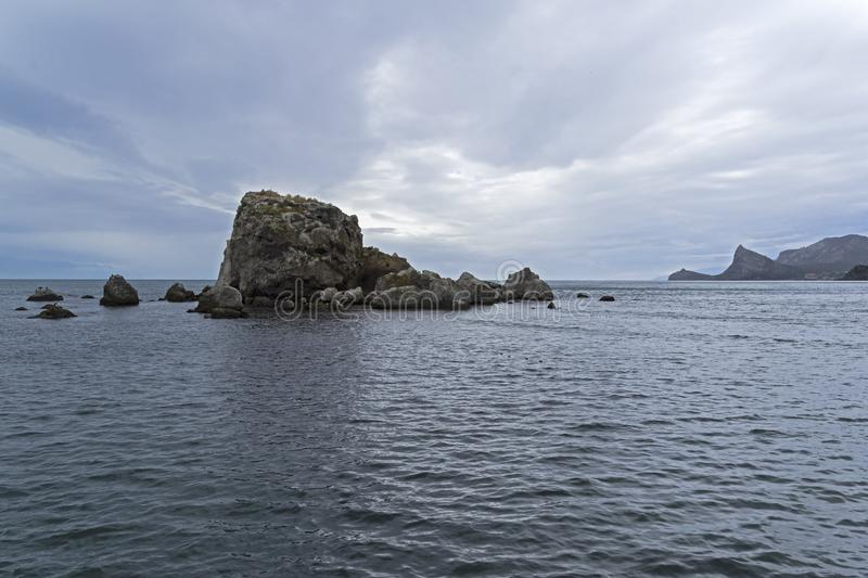 A small rocky island royalty free stock image