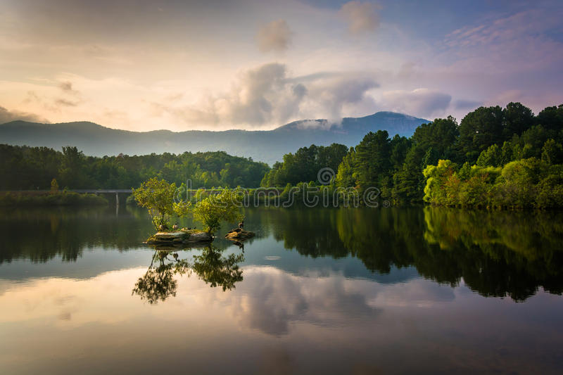 Small rocky island and view of Table Rock at Lake Oolenoy, Table. Rock State Park, South Carolina stock images