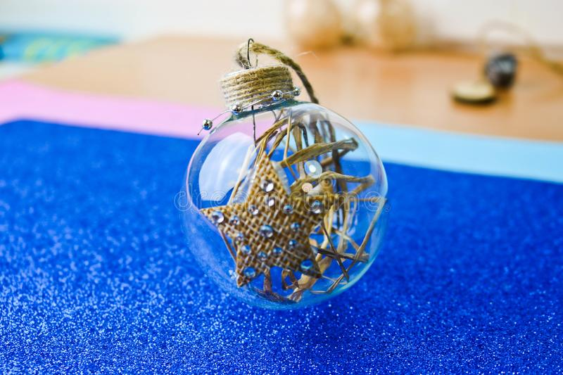 Small round glass transparent vintage homemade smart hipster decorative Christmas festive Christmas ball, Christmas tree toy. Small round glass transparent royalty free stock images