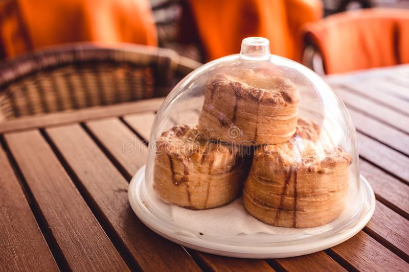 A small round pastry as a snack in a restaurant. A compliment from the chef, a Hungarian restaurant and cafe has such a service, a European tradition, plate royalty free stock photo