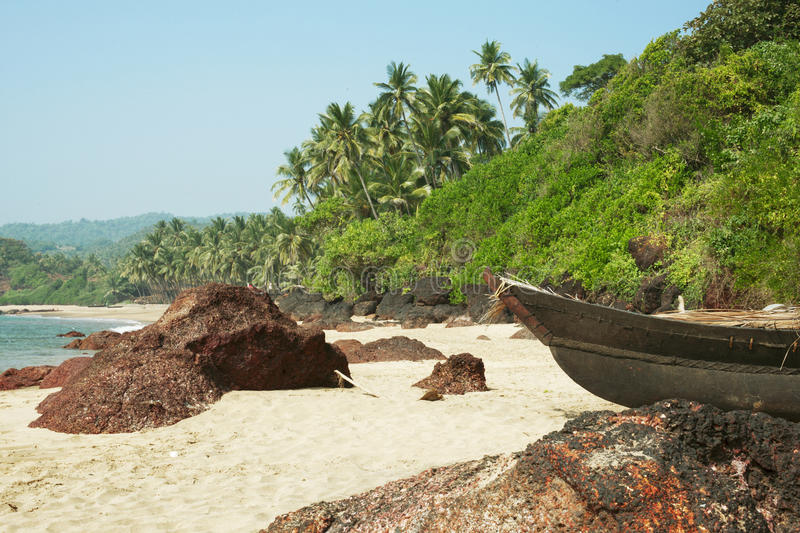 Small row boats laying on a beach royalty free stock images