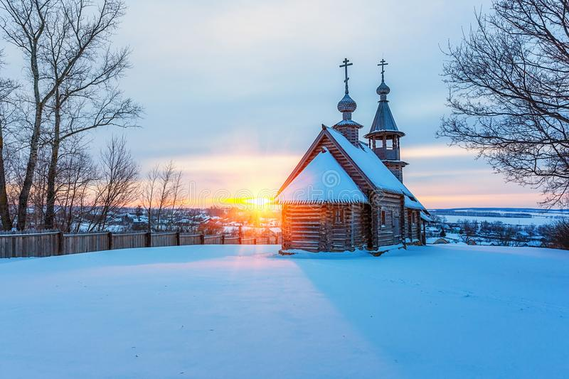 Russian church in winter forest stock photos