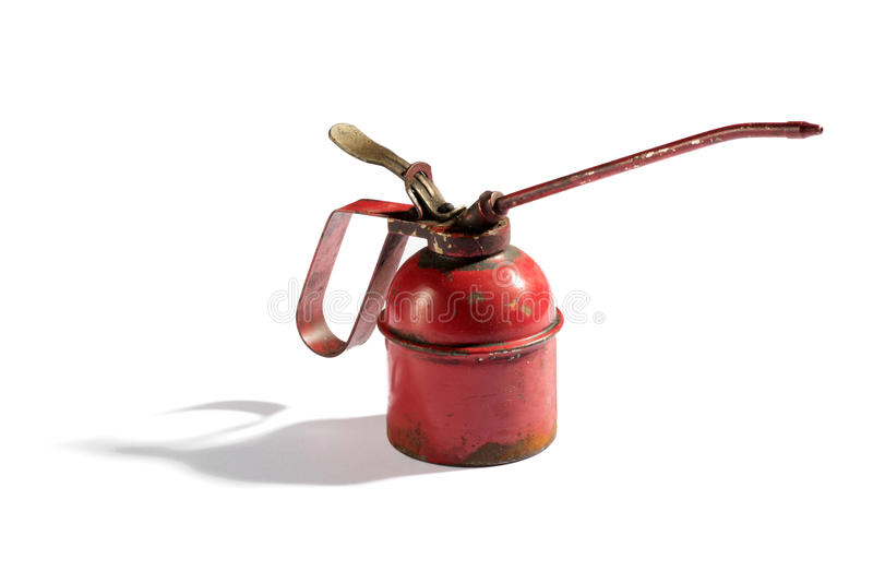 Small rusting vintage red oil can dispenser royalty free stock photos
