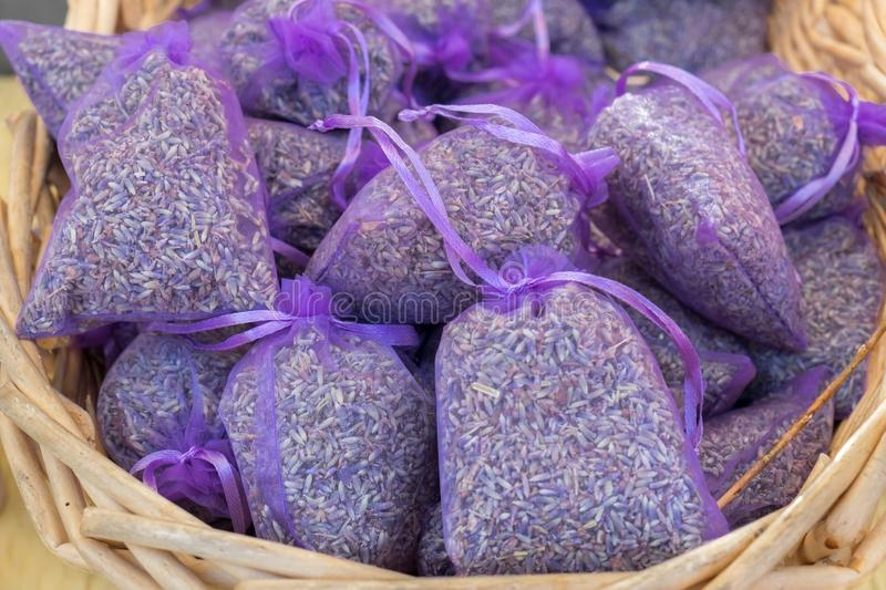 Small sacks with dried lavender herb sold at local city market. Provence stock photo