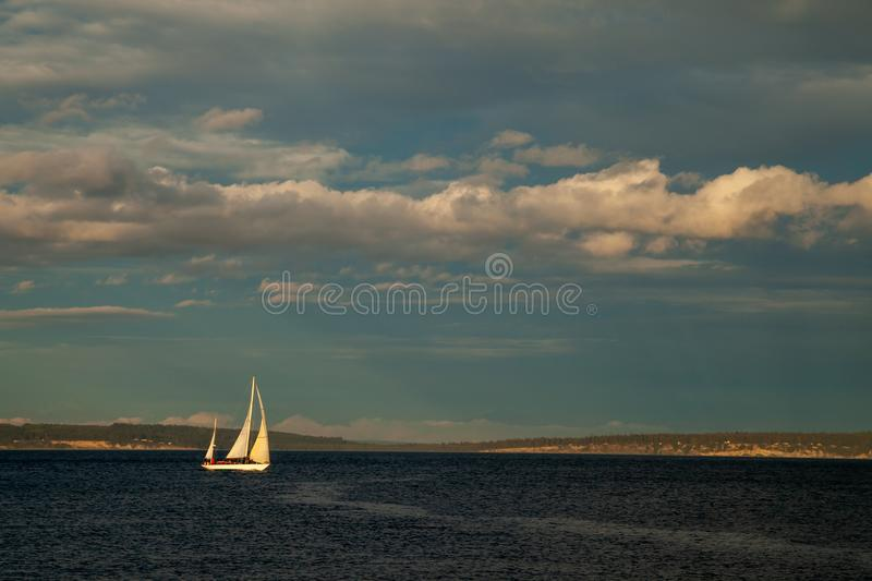 A small Sailboat on the water at sunset near Port Townsend, Washington. USA stock image
