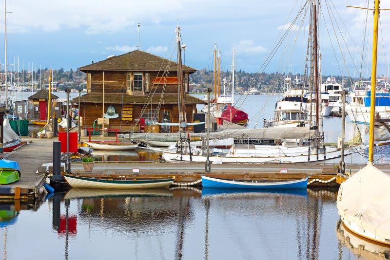 Small sailboats and rowboats near the Wooden Boats museum. royalty free stock photos