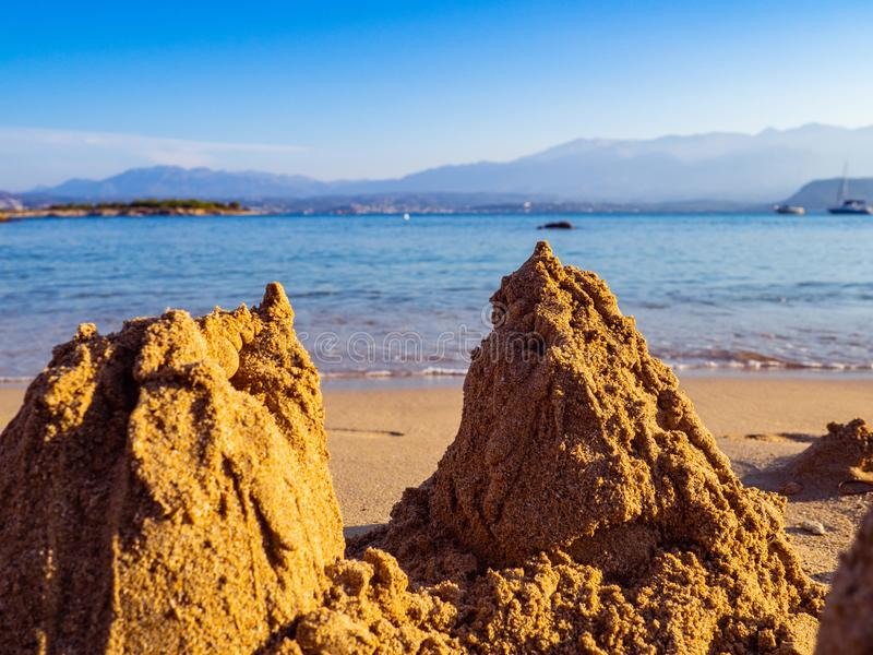 Small sand piles on the beach, evening shot royalty free stock images