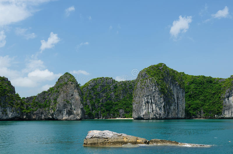Small sandy beach in the Halong Bay in Vietnam royalty free stock images