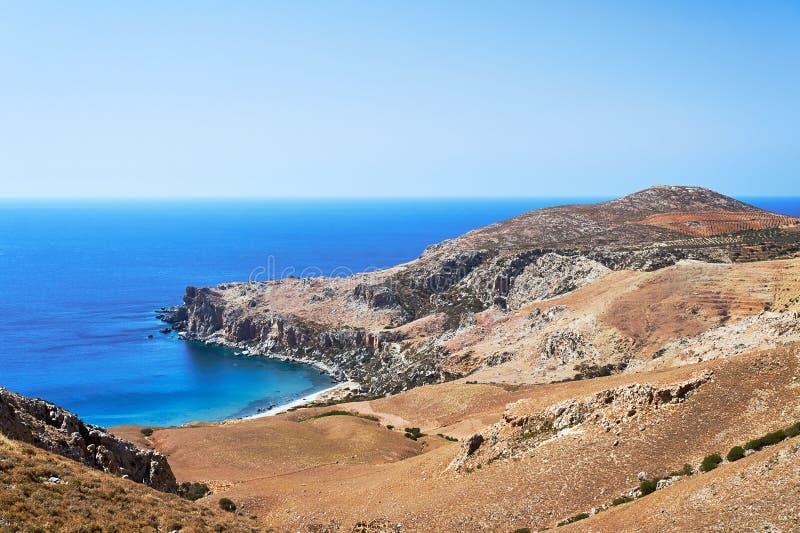 A small sandy beach on the rocky Mediterranean coast royalty free stock photos
