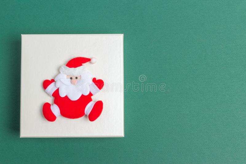 Small Santa Claus on a Christmas Day Gift Box royalty free stock photos
