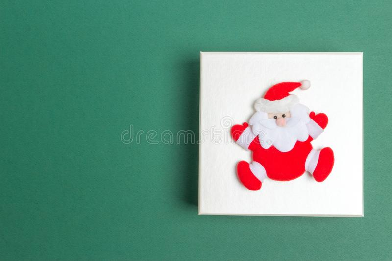 Small Santa Claus on a Christmas Day Gift Box stock photo