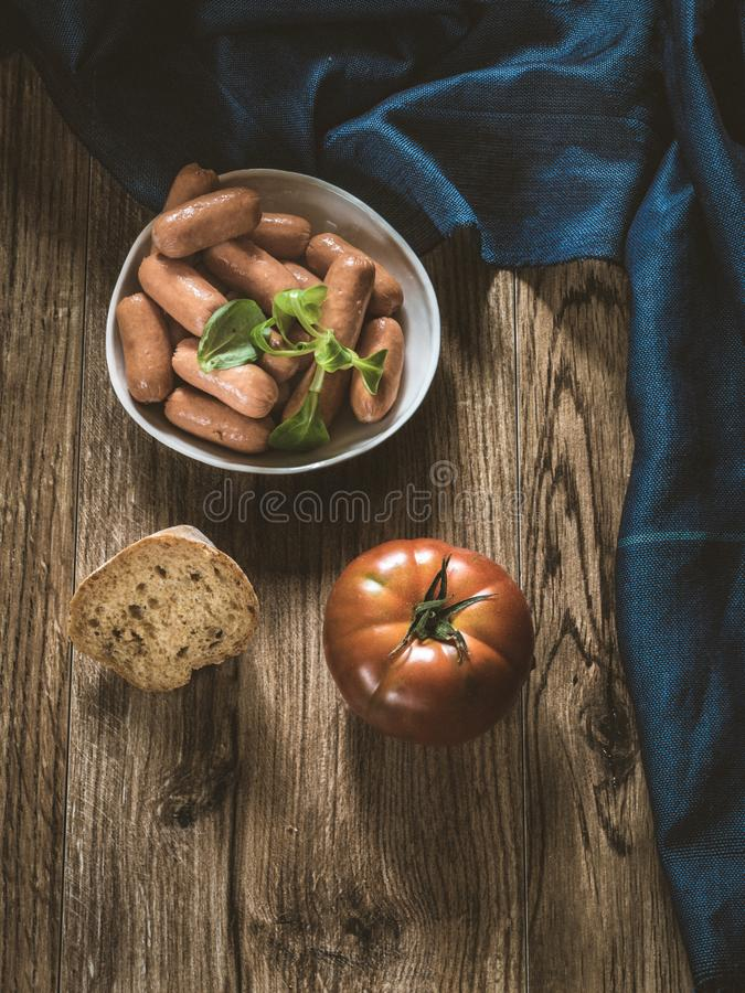 Small sausages on wood royalty free stock photos