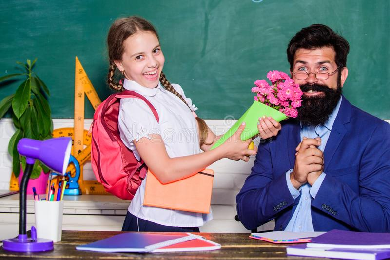 Small school girl kid with flower bouquet. back to school. Happy teachers day. knowledge day is 1 september. teachers. Small school girid with flower bouquet stock photos
