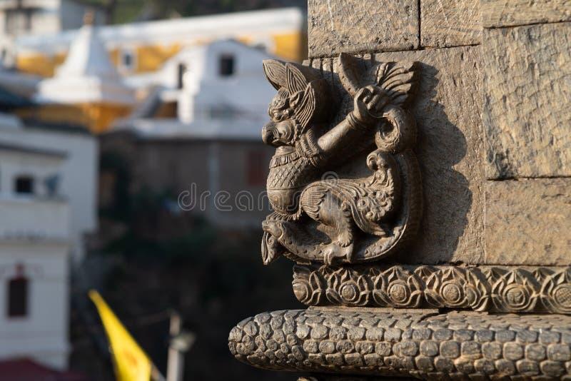 Small sculpture Garuda ornementing a temple stock image