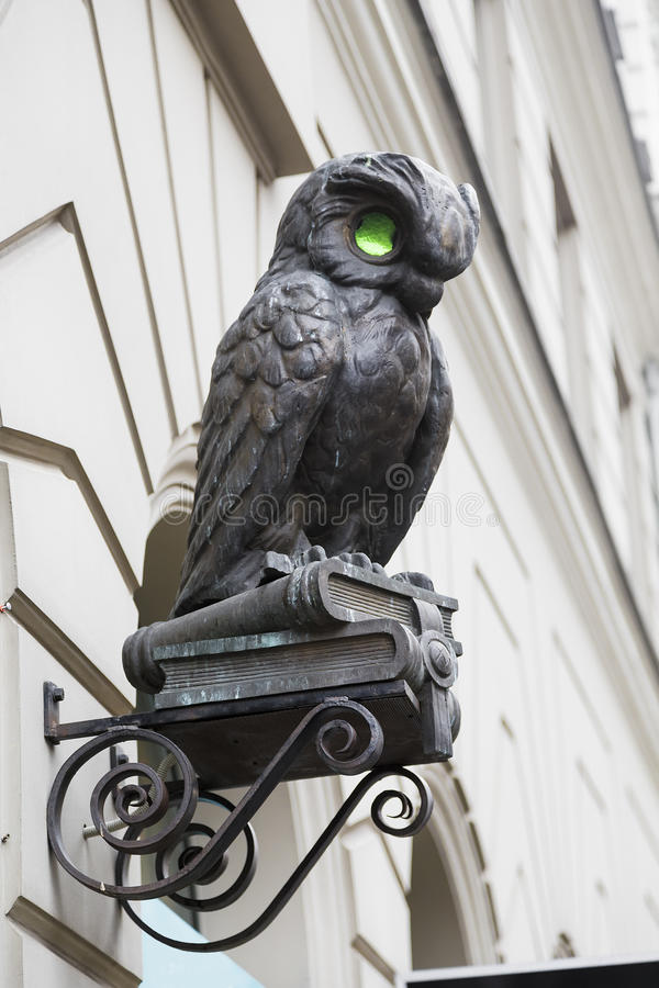 Small sculpture of owl. Over the entrance to the building royalty free stock photos