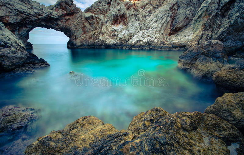 A small sea lagoon with a stone arch, Crete stock images