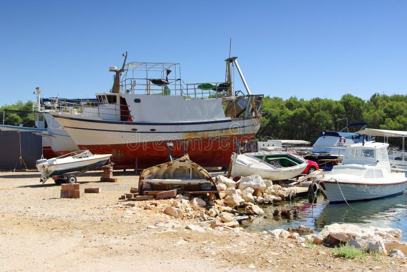 Small sea shipyard and harbor, ship repair royalty free stock photos