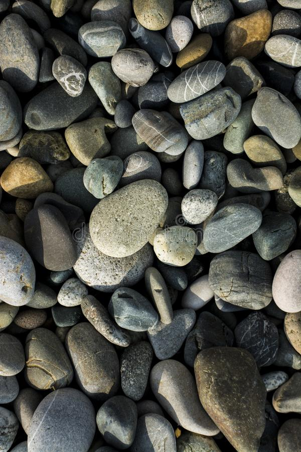 Small sea stones, gravel background texture stock images