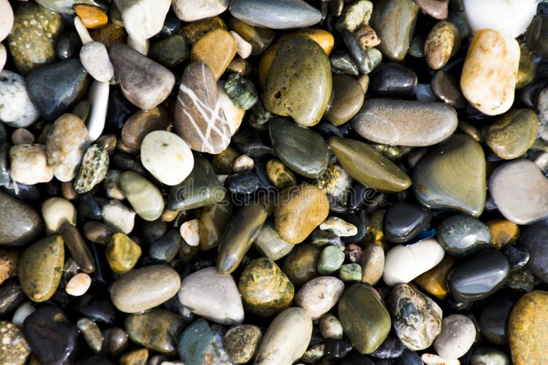 Small sea stones, pebbles royalty free stock photos