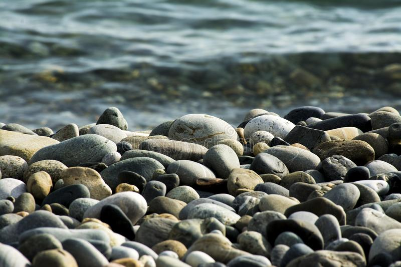 Small sea stones, pebbles stock images