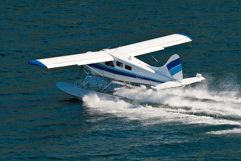 Small Seaplane Landing in Alaska royalty free stock images