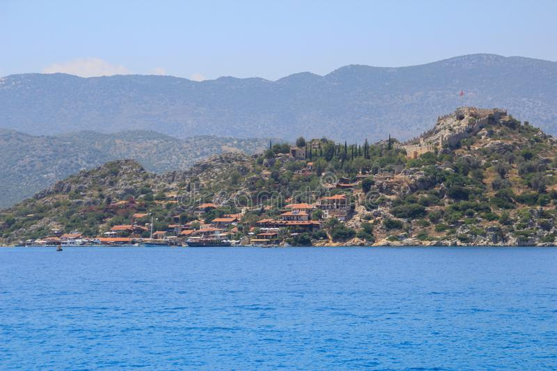 A small seaside town in the Bodrum area, Turkey in the Mediterranean Sea against the background of rocks and mountains. royalty free stock photo