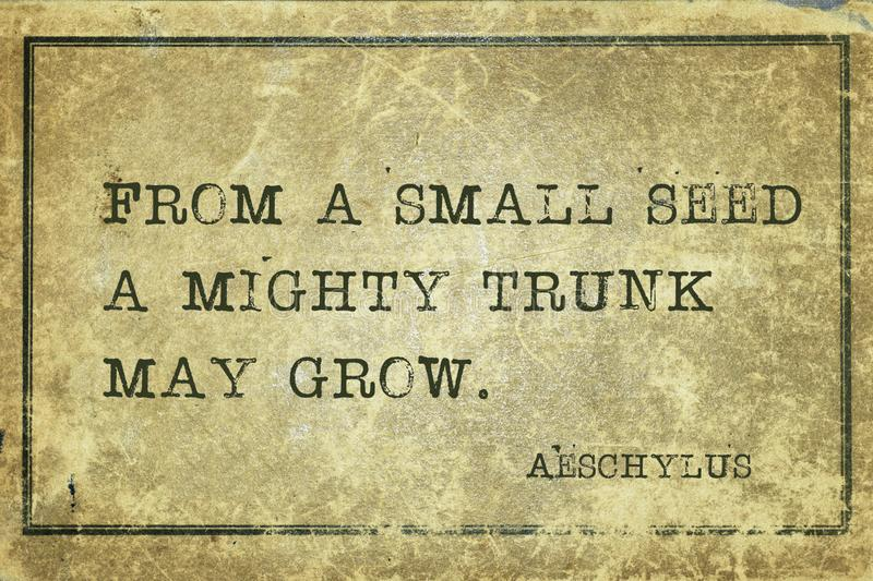 Small seed Aeschylus. From a small seed a mighty trunk may grow - famous ancient Greek tragedian Aeschylus quote printed on grunge vintage cardboard stock images