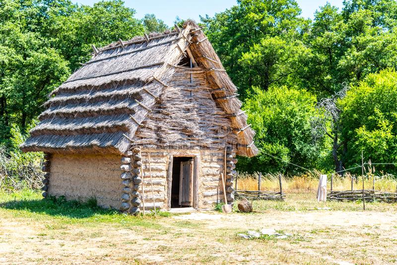 Small shepherd hut with straw roof on sunny day.  stock photography