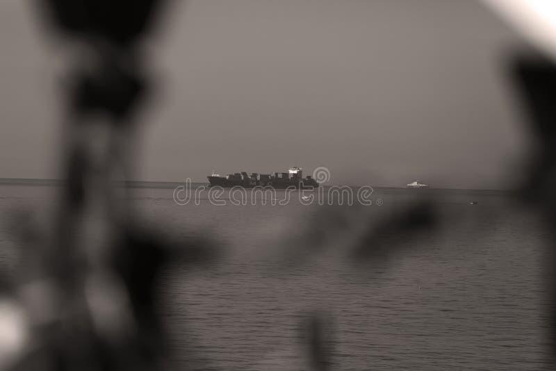 Small ship cruising in the sea. Small ship cruising into the ocean stock photography