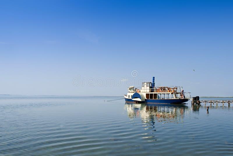 Small ship at the pier. Sea of Azov. Ukraine royalty free stock image