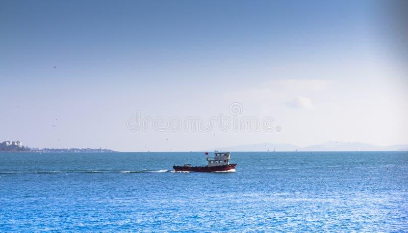 Small ship in the sea. Blue sky and blue sea. Small ship in the sea.Blue sky and blue sea stock photography