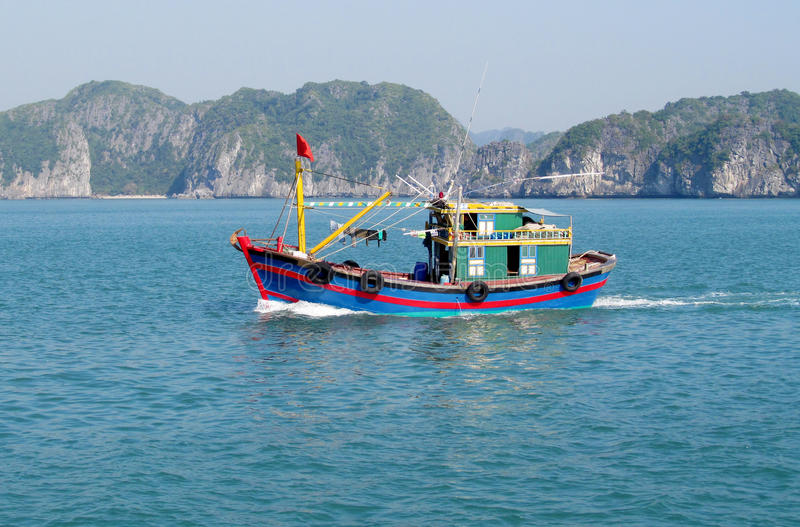 Small ship in water. Small colorful ship boat in water. fishing boats and small boats in the water royalty free stock photos