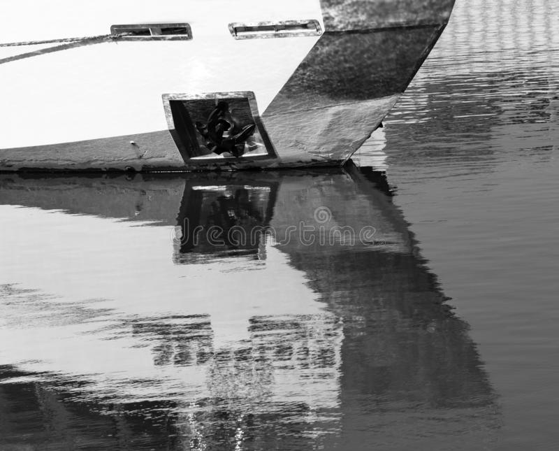 Small ship in the water with reflection.  stock image