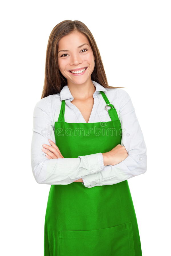 Small shop owner woman. Small shop owner, entrepreneur or sales clerk standing happy and proud wearing apron. Young woman isolated on white background royalty free stock images