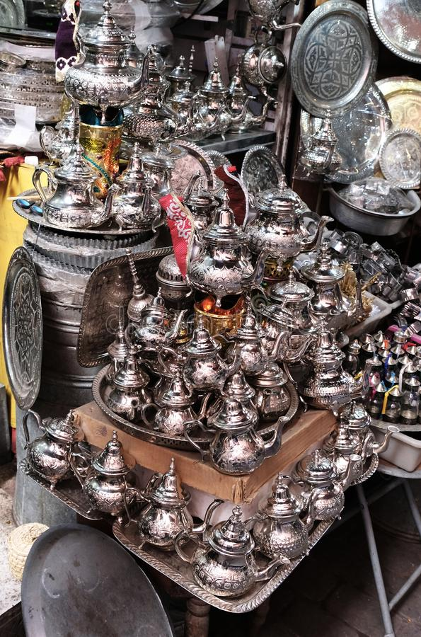 A small shop selling metal tableware at a market in Morocco.  stock image