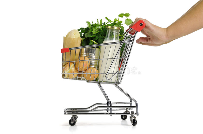 Small shopping cart. Hand pushing small shopping cart full with groceries isolated in white stock photos