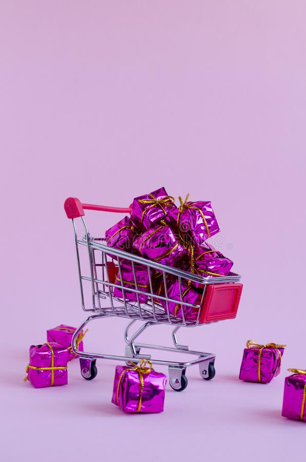 Small shopping cart with presents royalty free stock images