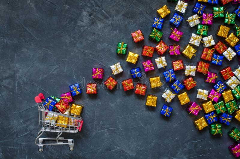 Small shopping cart with presents royalty free stock image