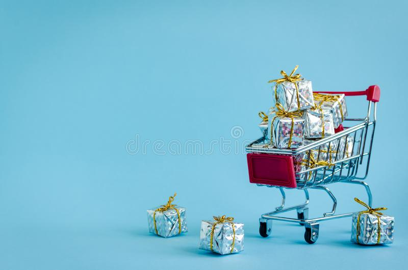 Small shopping cart with presents royalty free stock photos