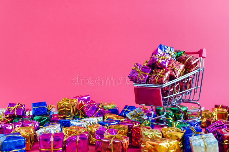 Small shopping cart with presents royalty free stock photography