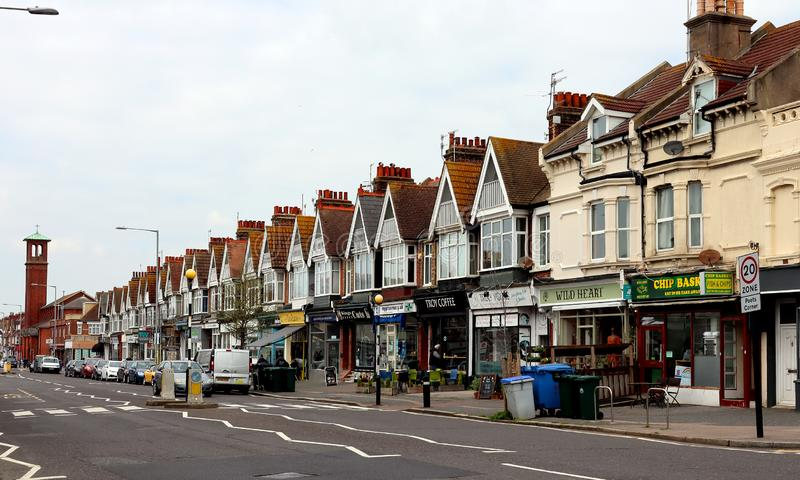 Small shops on Portland Road in Hove. A row of small independent shops with cars parked in front of them on Portland Road, Hove, Sussex, England royalty free stock photography