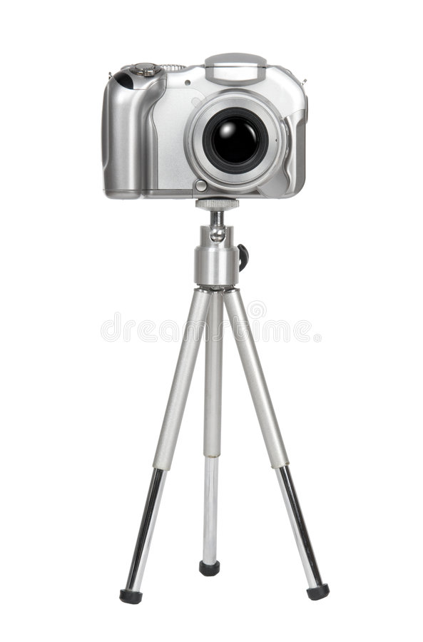 Small silver camera on a tripod royalty free stock images