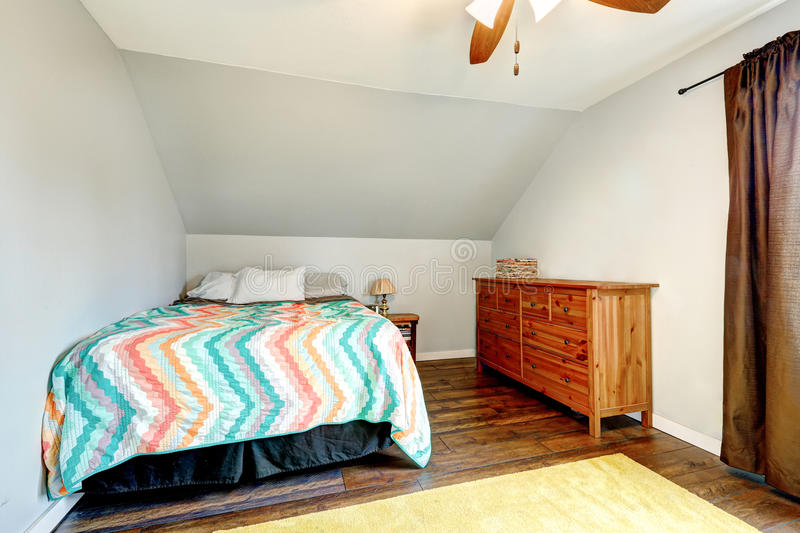Small simple style upstairs bedroom stock photography