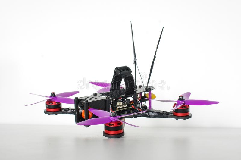 Racing quadcopter isolated on the white background. Small size racing drones isolated on the white background stock photography