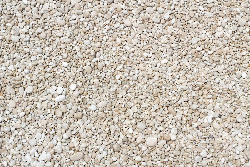 Small smooth pebbles texture stock images
